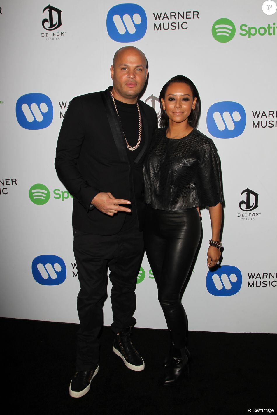 Melanie Brown (Mel B) et son mari Stephen Belafonte à la Soirée de Warner Music Group lors des Grammy Awards au Chateau Marmont à Los Angeles, le 8 février 2015.