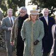 Sir David Tang et sa femme Lucy à la messe dominciale en l'église de Hillington le 17 janvier 2016, en présence de la reine Elisabeth II et du duc d'Edimbourg.