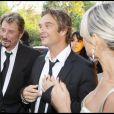 Johnny, Laeticia et David Hallyday à Paris en 2008