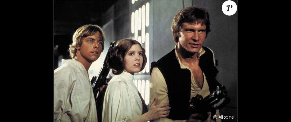 Mark Hamill aux côtés de Carrie Fisher et Harrison Ford.