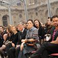 Lorenzo Marlone et Gong Li au défilé Vuitton le 12 mars