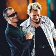 Johnny Hallyday en duo avec Florent Pagny au Stade de France, le 6 septembre 1998.
