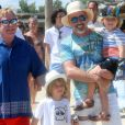 Elton John et son mari David Furnish quittent le club 55 à Saint-Tropez le 12 août 2016. Ils sont avec leurs enfants Elijah et Zachary.