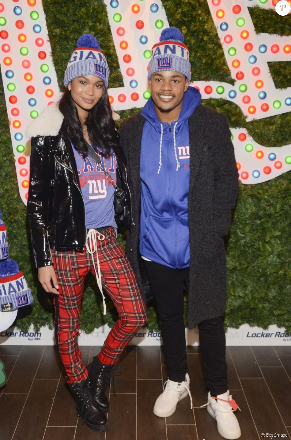 Chanel Iman et son fiancé Sterling Shepard assistent au lancement de la nouvelle collection 'New Era' dans le magasin Macy's Herald Square à New York, le 12 décembre 2017.