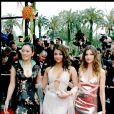 Laetitia Casta aux côtés d'Aishwarya Rai et Gong Lee, également égéries L'Oréal Paris, à Cannes en 2004.
