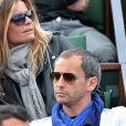 Denis Brogniart et sa femme Hortense assistent au match de Gael Monfils au 2eme Tour des Internationaux de France de tennis de Roland Garros le 29 mai 2013.