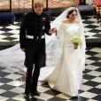 La duchesse Meghan de Sussex (Meghan Markle) dans sa robe Givenchy, dessinée par Clare Waight Keller, lors de son mariage avec le prince Harry le 19 mai 2018 à Windsor.