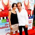 """Stéphane Henon et sa femme Isabelle - Avant-première du film """"Fiston"""" lors du 11ème festival """"Les Hérault du cinéma et de la télé 2014"""" au Cap d'Agde, le 28 juin 2014."""