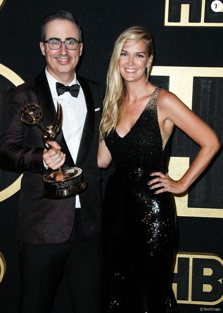 John Oliver, Kate Norley lors du photocall lors de l'afterparty HBO des Emmy Awards au Plaza, Pacific Design Center à West Hollywood le 17 septembre 2018.