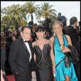 Lio accompagnée de Jean-François Lepetit et de sa fille Nubia, le 20 mai 2009 au Festival de Cannes. Elles portaient des créations Vivien Viviani.