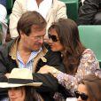 Hubert Auriol et sa femme lors du tournoi de Roland Garros le 27 mai 2009