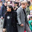 Le prince Harry, duc de Sussex, et Meghan Markle, duchesse de Sussex, enceinte, visitent le Bristol Old Vic. à Bristol le 1er février 2019.