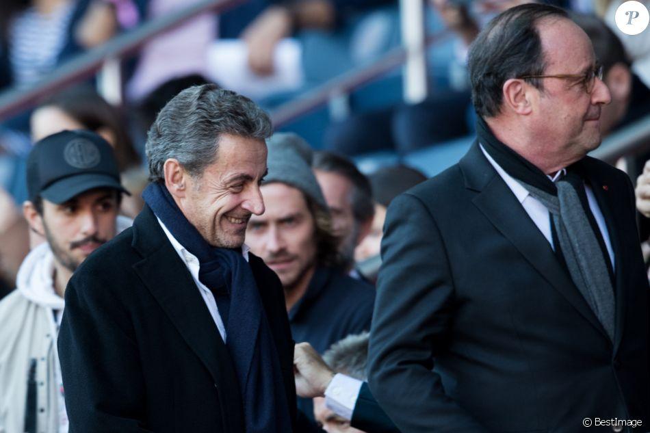 Nicolas Sarkozy et François Hollande lors du match de Ligue 1 entre le Paris Saint-Germain et Nîmes au Parc des Princes le 23 février 2019.