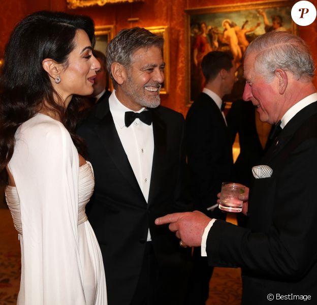 """George Clooney et sa femme Amal Clooney avec le prince Charles - Dîner """"The Princes Trust"""" au Buckingham Palace à Londres, le 12 mars 2019."""