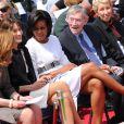 Sarah Gordon, Carla Bruni-Sarkozy et Michelle Obama lors de la cérémonie en hommage à ceux qui sont morts pour la France. Cimetière de Colleville-sur-mer, le 6 juin.