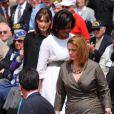 Louis Sarkozy qui escorte ces dames lors de la cérémonie en hommage à ceux qui sont morts pour la France. Cimetière de Colleville-sur-mer, le 6 juin.