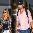 La chanteuse Fergie et son mari Josh Duhamel arrivent à l'aéroport de JFK à New York, le 9 juin 2014.