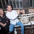 Daniel Ducret, avec à côté de lui sa mère Maguy, prend en photo sa femme Kelly-Marie Lancien et leur fille Linoué Ducruet lors du défilé de la première collection de la marque de vêtements de Pauline Ducruet, Alter Designs, printemps-été 2020, à La Cartonnerie à Paris le 18 juin 2019. © Cyril Moreau/Bestimage