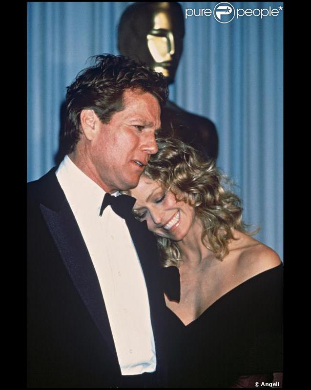Ryan O'Neal et Farah Fawcett en 1989