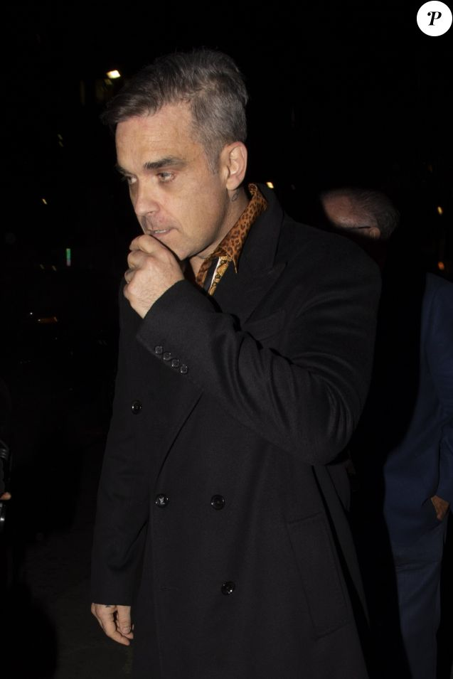 "Robbie Williams à la sortie du club ""Annabel's"" à Londres, le 6 juin 2019."