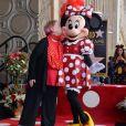 Minnie Mouse était accompagnée par la comédienne de doublage Russi Taylor, sa voix, en janvier 2018 lors de l'inauguration de son étoile sur le Hollywood Walk of Fame, à Los Angeles.