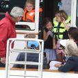 Le prince George et sa soeur Charlotte à la King's Cup avec leurs parents Kate Middleton et le prince William, le 8 août 2019.