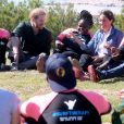 """Meghan Markle, duchesse de Sussex, et le prince Harry ont rencontré des membres de l'association """"Waves for Change"""" au Cap au matin de leur 2e journée en Afrique du Sud le 24 septembre 2019."""