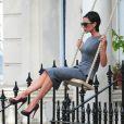 Victoria Beckham sur le shooting de sa prochaine collection de robes le 23/07/09 à Londres