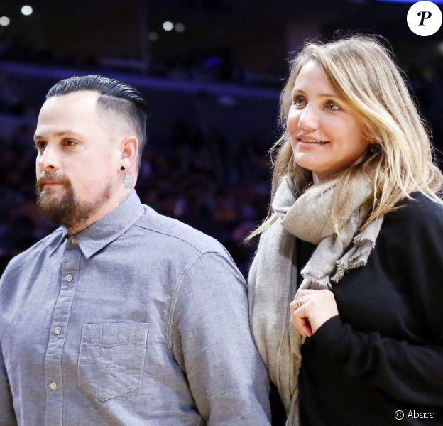 Cameron Diaz et son mari Benji Madden à un match de basket à Los Angeles en 2015.