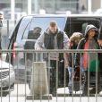 Exclusif - Violet, la fille de Christina Milian - M. Pokora et sa compagne Christina Milian (enceinte) prennent un vol pour Genève à l'aéroport Roissy CDG le 13 novembre 2019.