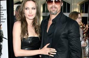 Angelina Jolie tellement sexy tout en cuir... enlace son Brad Pitt devant un parterre de stars !