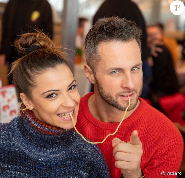 Christian Millette et Denitsa Ikonomova- Record du monde du plus grand Italian Kiss, le plus grand nombre de couples mangeant le même spaghetti, au restaurant Vapiano de La Défense, à Paris, le 14 février 2020, pour la Saint-Valentin.