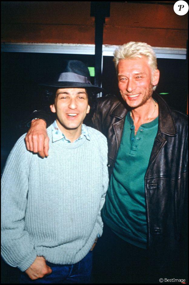 Michel Berger et Johnny Hallyday lors du concert de Michel Berger au Zénith de Paris en 1986.