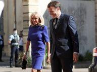 Brigitte Macron complice et solennelle avec le président avant le défilé