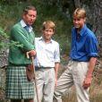 Le Prince Harry, son père le Prince Charles et son frère le Prince William 14/08/1997 -