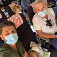 """Denis Brogniart et Christophe Beaugrand dans l'avion en direction de Nice, pour le tournage de """"Ninja Warrior"""", le 14 septembre 2020"""