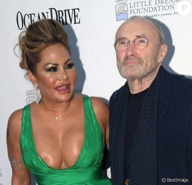 """Phil Collins et sa femme Orianne au photocall du 4e gala de la fondation """"Little Dreams"""" à Miami."""