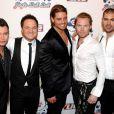 """Les quatre """"survivants"""" de Boyzone ont rendu le 17 octobre un hommage bouleversant à leur """"petit frère"""" décédé Stephen Gately (à gauche)"""