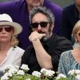 Emmanuelle Béart et Frédéric Chaudier dans les tribunes des Internationaux de France de Tennis de Roland Garros à Paris, le 10 juin 2018. © Dominique Jacovides - Cyril Moreau/Bestimage