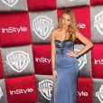 Blake, véritablement délicieuse dans sa sublime robe bustier signée Nina Ricci, lors des Golden Globe 2009...