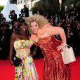 Surya Bonaly et Velvet d'Amour portent des tenues signées Christophe Guillarmé sur la Croisette (13 mai 2010 à Cannes)