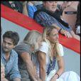 Philippe Lucas en charmante compagnie, lors du match PSG-AS Roma durant le Tournoi de Paris, au Parc des Princes, le 1er août 2010.