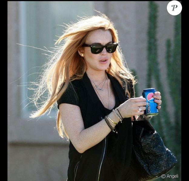 Lindsay Lohan est photographiée à la sortie de son domicile de Palm Desert, lundi 15 novembre.