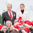Charlène Wittstock et Albert de Monaco lors du Noël de la Principauté le 15 décembre 2010