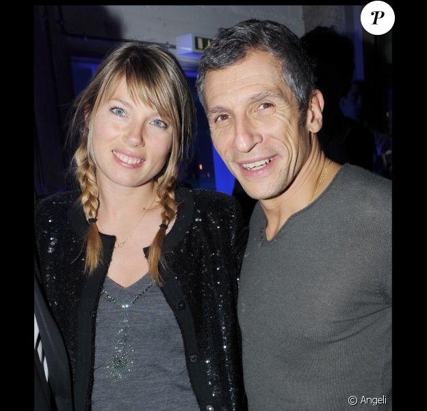 Nagui et sa femme Mélanie à l'anniversaire de Jean-Charles de Castelbajac, organisé à la Cité de la mode et du design, à Paris. 15/12/2010