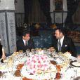 Nicolas Sarkozy et Carla Bruni à la table du roi du Maroc, le 27 décembre 2009.