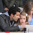 Luis Figo explique le tennis à sa fille Martina aux Masters 1000 de Madrid, le 6 mai 2011