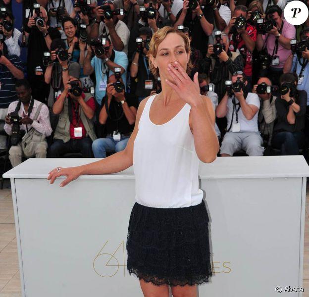 Cécile de France pose pour le photocall du Gamin au vélo, des frères Dardenne, le 15 mai 2011, lors du 64e festival de Cannes.