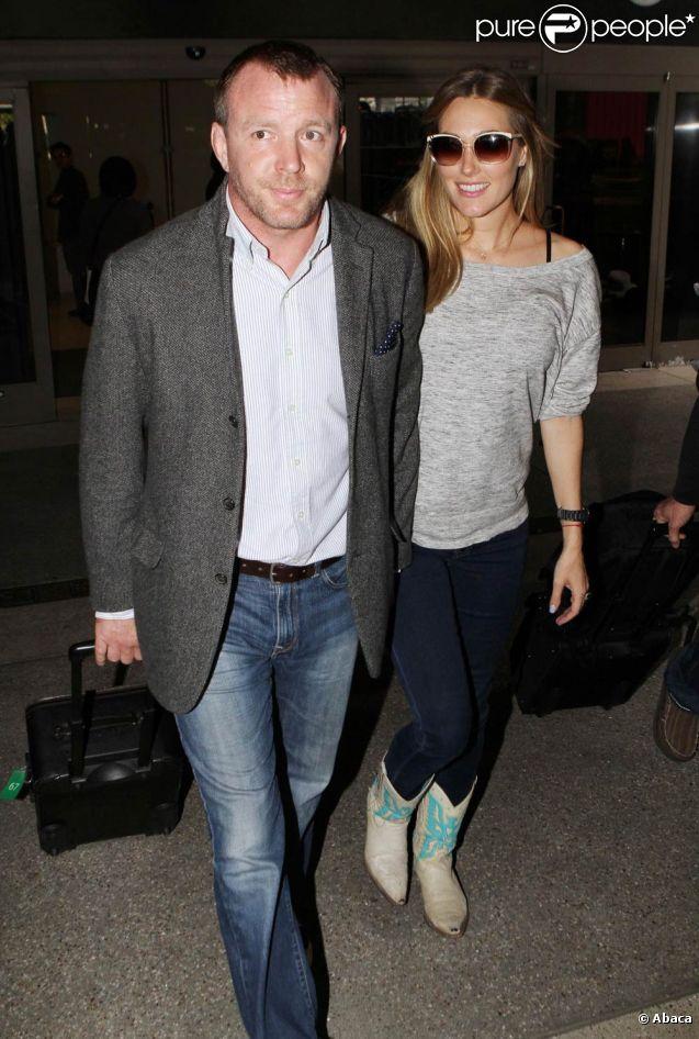 Guy Ritchie et sa compagne enceinte  Jacqui Ainsley, à Londres, le 14 mai 2011.