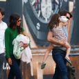 Katie Holmes, Tom Cruise et Suri vont prendre l'hélicoptère, à New York, le 9 août 2011.